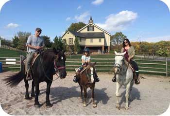 family on horses